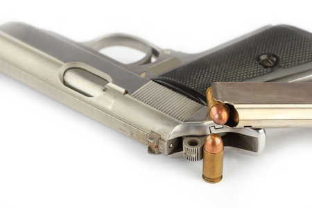 special steel: Close up of bullets and Semi-automatic gun on white background