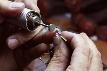 jewel hands: Close up of repairing ring by polishing motors tool