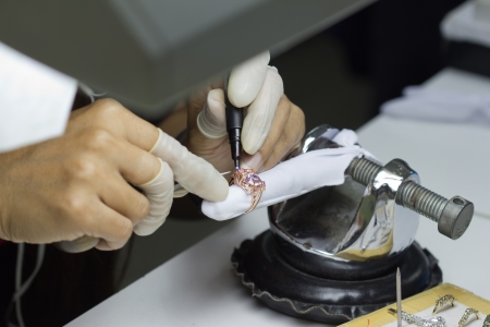 qc: QC staff using marking pen for repair for jewelry ring  Stock Photo