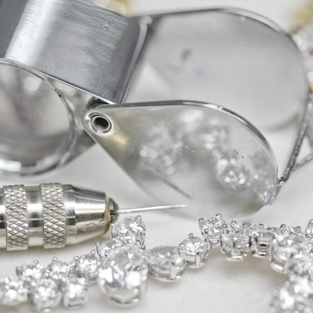 Bracelet with diamond and repairing jewelry tools  loupe,pliers  Stock Photo