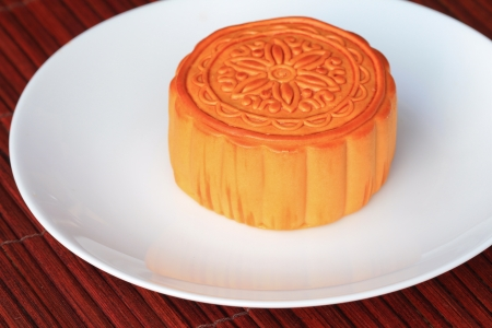 Chinese Moon cake on white dish , Chinese tradition  photo