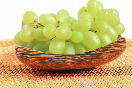 Green grapes in a wooden tray