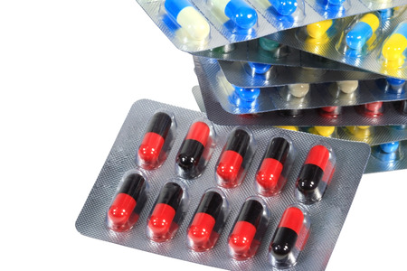 various pills capsule isolated on white