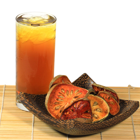 Bael  dried and bael juices on wood plate  [Aegle marmelos]