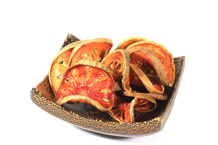 Bael  dried on wood plate  [Aegle marmelos]  Stock fotó