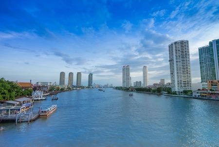 riverside trees: Sky scape on Silom Stock Photo