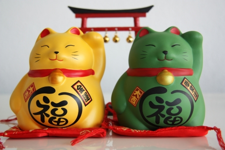 Japan lucky cat Beck money and fortune Stock Photo - 17589492