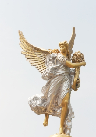 Statue of an angel holding a flower. Stock Photo - 18090991