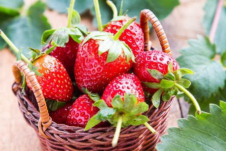 Strawberry in a basket on the table.