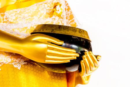 limosna: Buda sostiene un cuenco de las limosnas Foto de archivo