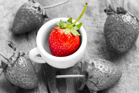 Strawberry with red, but black and white and color performance. Stock Photo
