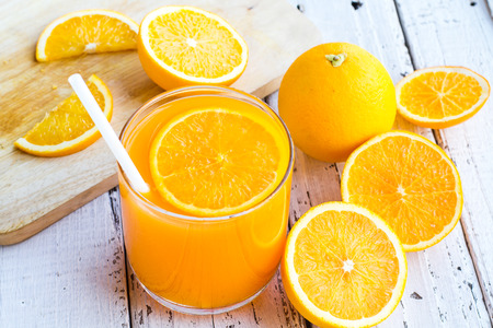 orange cut: Be cut to remove the orange juice to drink and eat and be healthy. Stock Photo