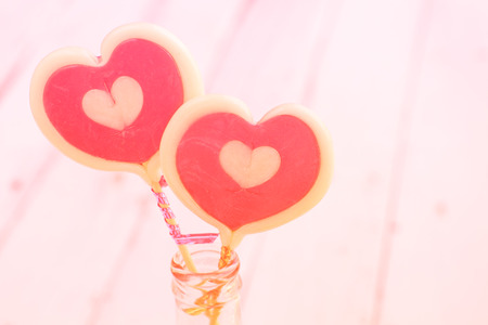 Candy hearts with loving and sweet. And the Valentine lovers and painted in soft pastel colors. Stock Photo