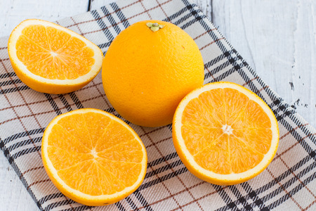 Be cut to remove the orange juice to drink and eat and be healthy. Stock Photo