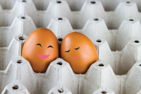 Two chicken eggs painted like a lover.