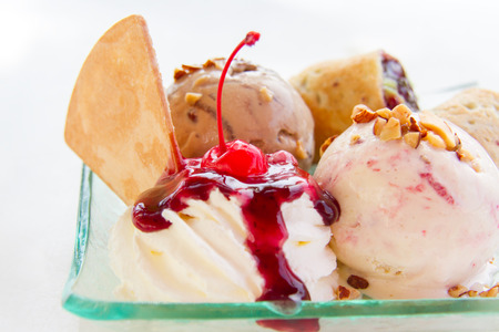 Ice cream topped with a sweet blue berries wrapped in a soft dough and cherry red. Stock Photo