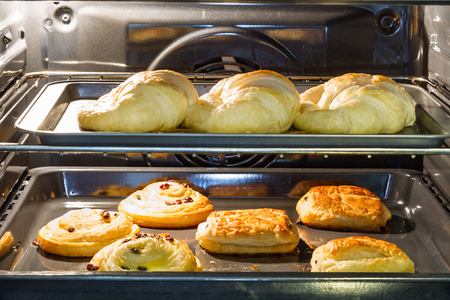 palatable: Croissants are baked in the oven with sweet and palatable. Stock Photo