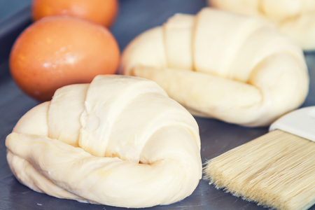not ready: Flour and croissants are not yet ready to bake and roast until fragrant and delicious with a black vintage. Stock Photo