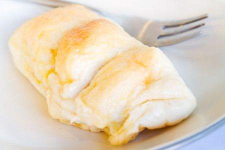 The soft, sweet and delicious bread on a white plate. Stock Photo
