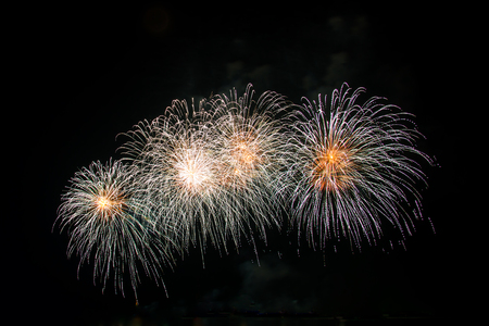 fun background: New Years fireworks celebration of the old year and the new year.