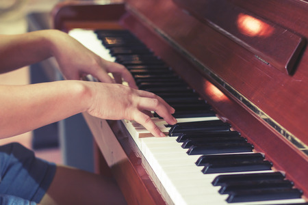 melodious: The melodious sound of the piano being played by a musician.