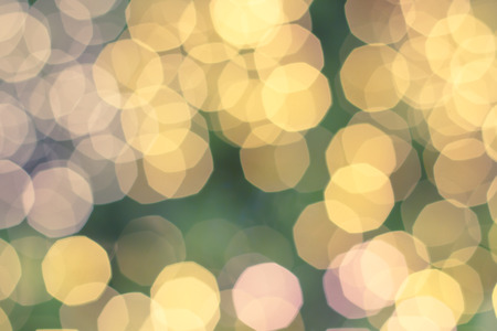brighten: Blur shining brighten wallpaper with circle bulbs lights abstract blurred background in warm toned blurry soft of golden yellow orange colored  festive wallpaper conception. Stock Photo