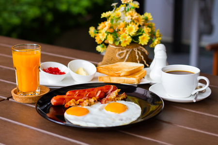 beneficial: Breakfast with bacon, fried egg are beneficial to health. Stock Photo
