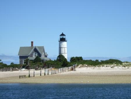 a lighthouse on a New England beach