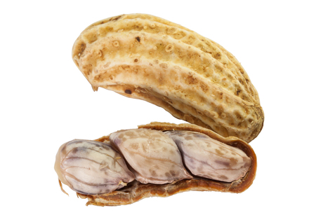 boil: Closeup of half brown boil peanut on white background