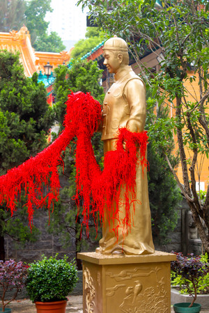 Closeup of Gold God of marriage part man in Wong Tai Sin Temple