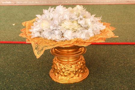 Close up of alms flowers (Ribbon flowers),Thai culture on the golden tray