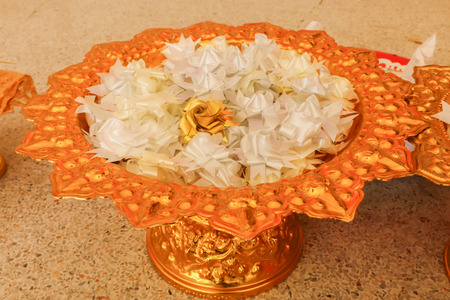 Group of white alms flowers (Ribbon flowers),Thai culture on the golden tray