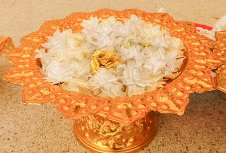 Group white alms flowers (Ribbon flowers),Thai culture on the golden tray