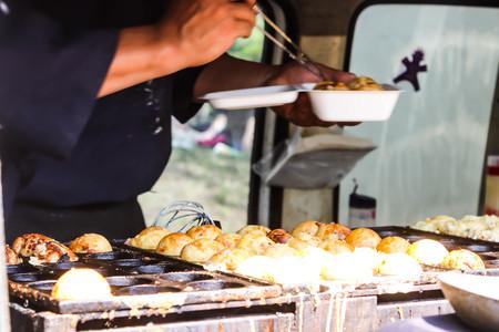 Process Cooking Takoyaki on hot pan Famous food in Japan street food