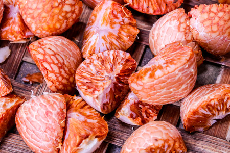 Closeuo of red Betel nut fresh betel palm on wooden Stock Photo