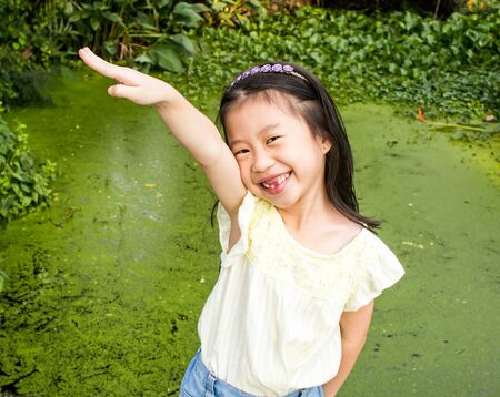 Acting of Asian little girl wear cute clothes