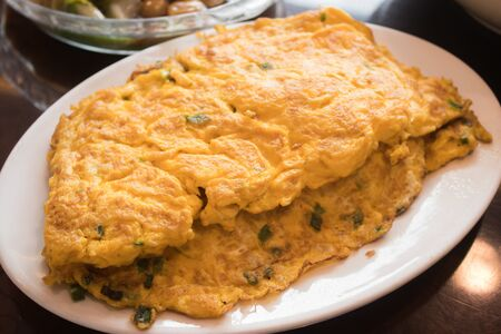Closeup of omelette with fresh green onion, scrambled eggs 写真素材
