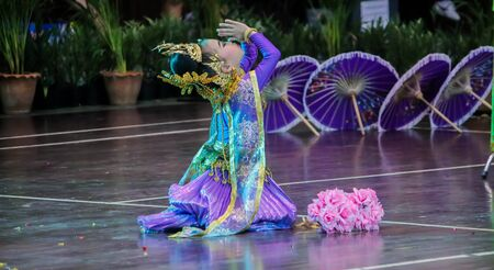 Single Little child girl Thai dance and press the hands together at the chest or forehead in sign of respect. Stock Photo