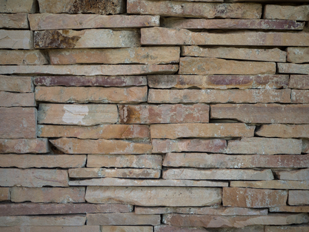 stacked stone: Background  Stacked Stone Wall. Stock Photo