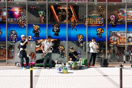 Street musicians playing in front of a videogame shop at Akihabara district
