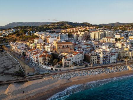 Aerial view of Sant Pol de Mar village and its church Ermita de Sant Jaume. Located in el Maresme coast, Catalonia