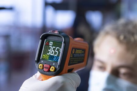 Laser infrared thermometer temperature control to an unidentifiable person