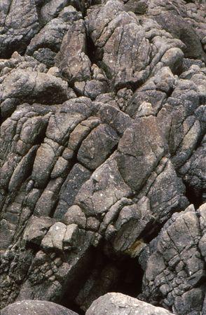 Strange rock pattern and cave along coastline