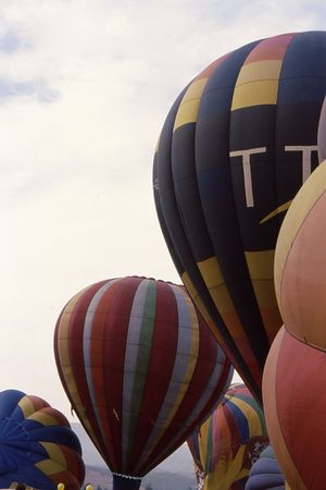 Hot air balloons filling up for their ascent
