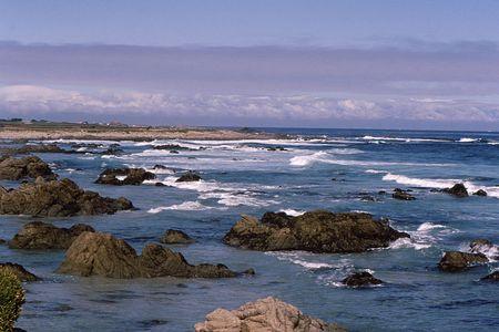 Rocky california costal scene under wintery sky Stock fotó