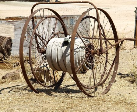 cart: Antique fire hose hand cart used at old railroad yard Stock Photo