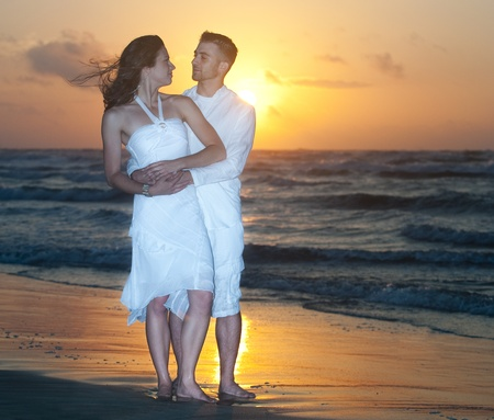 Man and woman on beach at sunset Stock Photo - 10501843