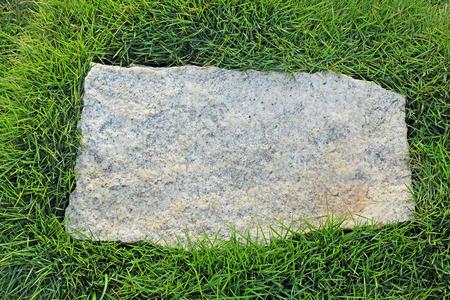 grass border: Rough rectangular granite stone with natural grass border