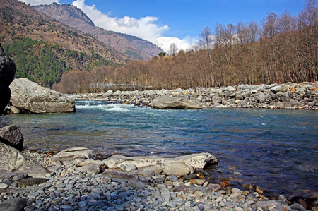 Beas river flowing through the Manali region of Himalayas. White water rafting is a popular sport here.