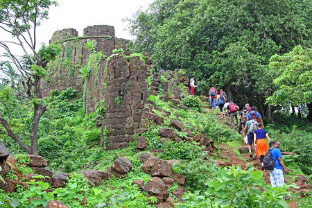weed block: Goa, India - July 10, 2016: Tourists at the ruins of  Cabo de Rama Fort in Goa, a centuries old fort, last owned by the Portuguese during their occupation of Goa.